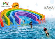 Anti - UV Inflatable Water Parks Triple Lanes PVC Rainbow Slide With Swimming Pool For Rentals