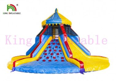 PVC Colorful Blow Up Carousel Dry Slide Tower Slide With Climbing Wall For Kids